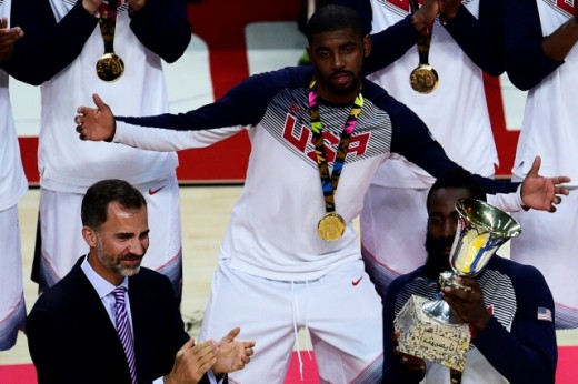 ALTERNATIVE CROP US forward James Harden (R) celebrates after receiving the trophy from Spain's King Felipe VI (L) after the 2014 FIBA World basketball championships final match USA vs Serbia at the Palacio de los Deportes in Madrid on September 14, 2014. USA won the match 129-92.  AFP PHOTO / PIERRE-PHILIPPE MARCOU